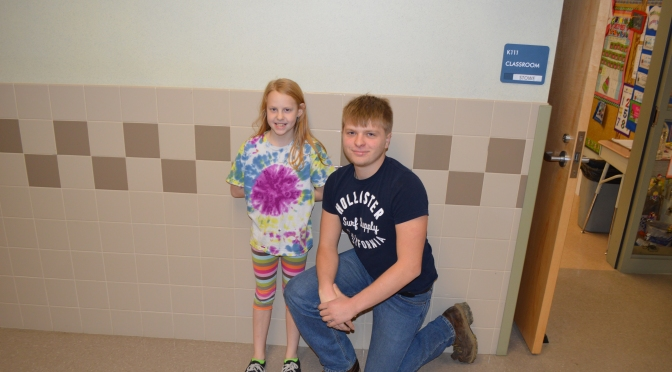 EHS senior, Jacob Hamilton, poses with an EES student.