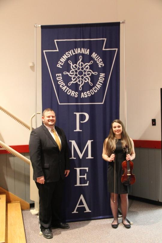 Senior, Kayla Kuppertz, and director, Mr. Napolitan, attend PMEA District Orchestra Festival in Meadville, PA.